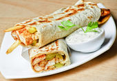 Eastern traditional shawarma plate with sauce — Stock Photo