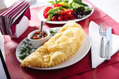Picture of cheburek wit red sauce ,traditional eastern food — Stock Photo
