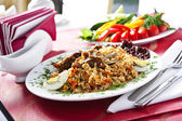 Plate of pilau ,traditional eastern dish — Stock Photo