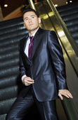 Yang businessman goes down by subway elevator — Stock Photo