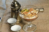 Oriental Arabic coffee dessert topped with nuts — Stock Photo
