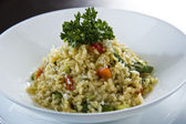Plate of risotto traditional Italian mixed rice — Stock Photo