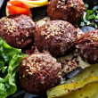 Tasty felafels meal with greens and pickles — Stock Photo