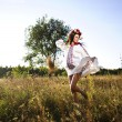 Stock Photo: Outdoor portrait of beautiful pregnant Slav woman