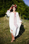 Outdoor portrait of yang and beautiful Slav woman dressed traditional way — Stock Photo