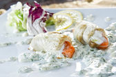 Plate of flatfish roll staffed with red salmon — Stock Photo