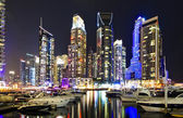 DUBAI, UAE -MARCH 10: View of modern skyscrapers in Dubai Marina on March 10, 2013 in Dubai, UAE. Dubai Marina - artificial canal city, carved along a 3 km stretch of Persian Gulf shoreline. — Stock Photo
