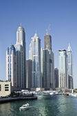 DUBAI, UAE - FEBRUARY 22: View of modern skyscrapers in Dubai Marina on February 22, 2013 in Dubai, UAE. Dubai Marina - artificial canal city, carved along a 3 km stretch of Persian Gulf shoreline. — Stock Photo