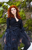Portrait beautiful red haired woman in winter forest — Stock Photo