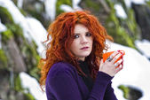 Portrait beautiful red haired woman in winter forest. — Stock Photo