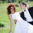 Wedding picture of European couple with red haired bride — Stock Photo