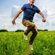 Adult and freaky village man performs on green field — Stock Photo #27815607