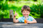 Yang little and cute boy pictured with glass of juice — Stock Photo