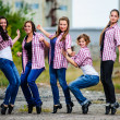 Group of yang European tap dancers perform outdoor. — Stock Photo #38807531