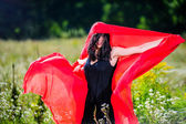Picture of sexy yang dark haired women with red fabric — Stock Photo