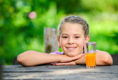 Yang pretty European girl posing with glass of orange juice — Stock Photo