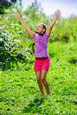 Little pretty girl enjoying warm summer rain — Stock Photo