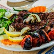 Plate of traditional eastern kebabs — Stock Photo