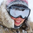 Woman smiling with goggles in winter — Stock Photo #13942827
