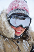 Woman smiling with goggles in winter — Stock Photo