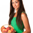 Pretty smiling woman with red peaches — Stock Photo