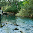 A fisherman fishing on a river — Stock Photo #13172294