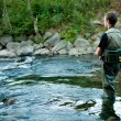 A fisherman fishing on a river — Stock Photo #13172923