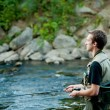 A fisherman fishing on a river — Stock Photo #13173101