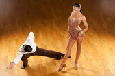 Latino dance couple in action - wild samba — Stock Photo
