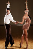 Latino dance couple in action - wild samba — Stock Photo