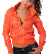 Funky young woman in orange jacket — Stock Photo
