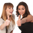Two happy young women with thimbs up — Stock Photo #13365583