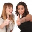 Two happy young women with thimbs up — Stock Photo