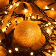 Stock Photo: Christmas ornaments - golden bauble