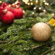 Christmas ornaments - golden baubles with shiny tape in backgrou — ストック写真