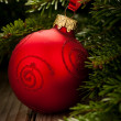 Christmas ornaments - red baubles with shiny tape in background — 图库照片