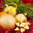 Christmas ornaments - golden baubles with shiny tape in backgrou — Stock Photo #16039911