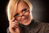 Beautiful young blonde with eyeglasses isolated — Stock Photo
