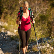 Woman on trekking - Beautiful blonde girl hiking on mountains — Stock Photo