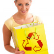 Young woman holding recycle paper bag. — Stock Photo