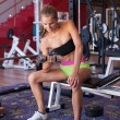 Active young woman works out with dumbell — Foto de Stock