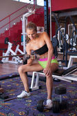 Active young woman works out with dumbell — Stock Photo