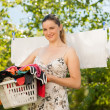 Young woman hanging laundry outdoor — Stock Photo