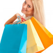 Attractive blonde girl with colorful shopping bags — Stock Photo #31837675