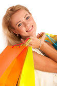 Attractive blonde girl with colorful shopping bags — Stock Photo