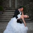 Bride and groom dancing their first dance — Stock Photo
