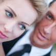 Closeup portrait of bride and groom with shallow depth of field — Stock Photo #32632729