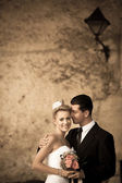 Retro portrait of bride and groom on a street — Stok fotoğraf