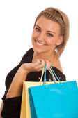 Attractive young woman with colorful shopping bags — Stock Photo