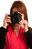 Young woman photographer with camera in her hand — Stockfoto